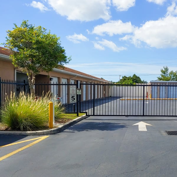 Gated access to outdoor storage units at StorQuest Self Storage in Sarasota, Florida