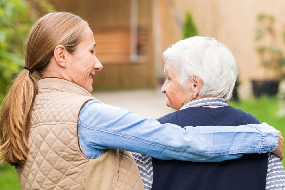Resident walking the grounds with caregiver at The Willows Retirement & Assisted Living in Blackfoot, Idaho
