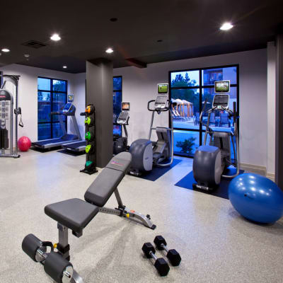 Well-equipped onsite fitness center at Sofi Warner Center in Woodland Hills, California