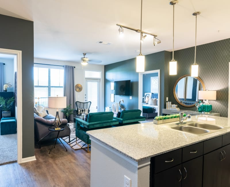 Beautifully lit open concept living spaces at Haven at Liberty Hills in Houston, TX