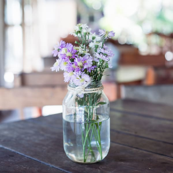 Purple flowers in a mason jar at Brio Apartment Homes in Glendale, California