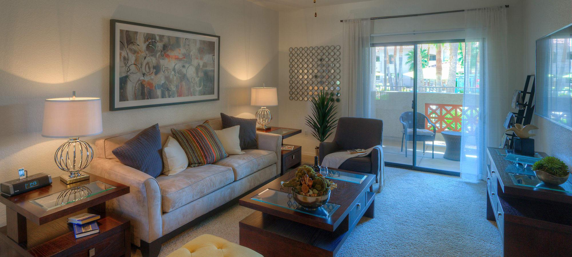 San Prado model living room with sliding glass door leading to private patio/balcony at San Prado in Glendale, Arizona
