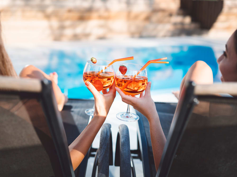 Residents sipping beverages poolside at Remington Ranch in Litchfield Park, Arizona