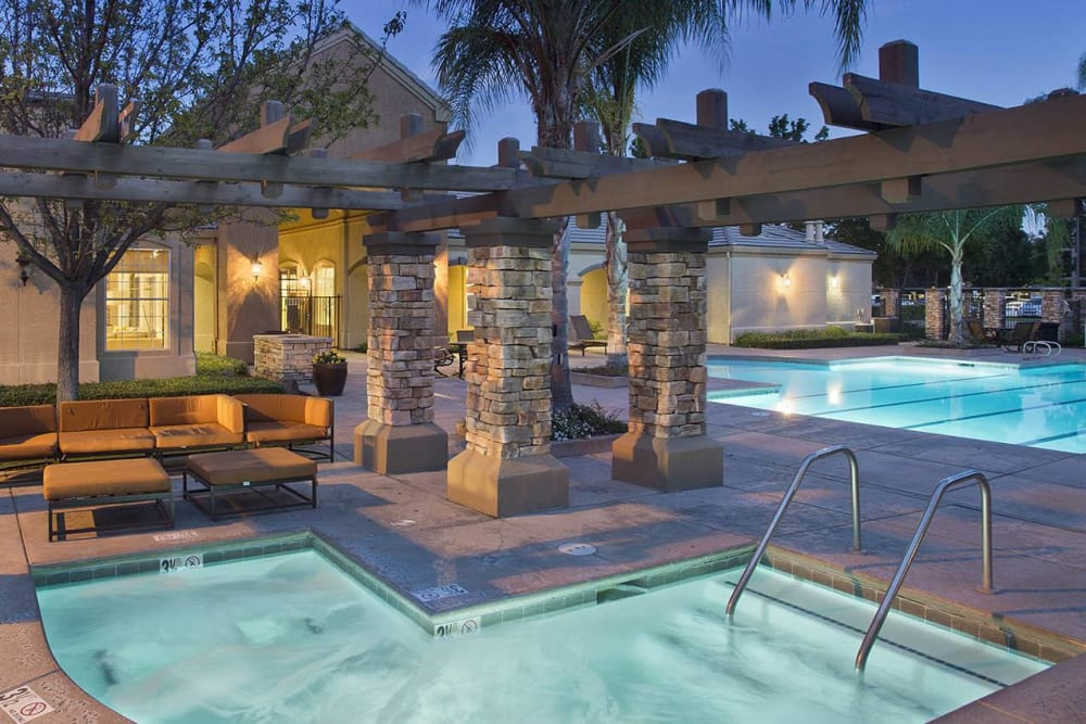 Resort-style spa and swimming pool at River Oaks Apartment Homes in Vacaville, California