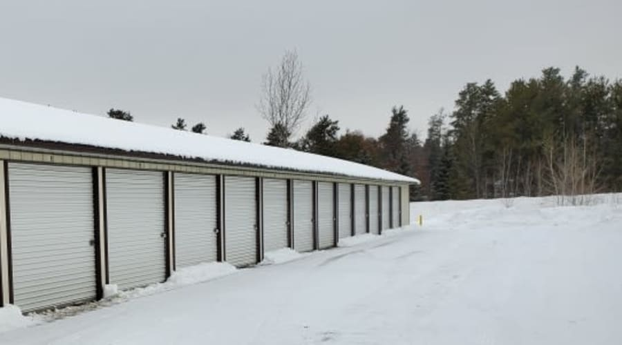 Storage units with white doors and locks at KO Storage of Baxter in Baxter, Minnesota
