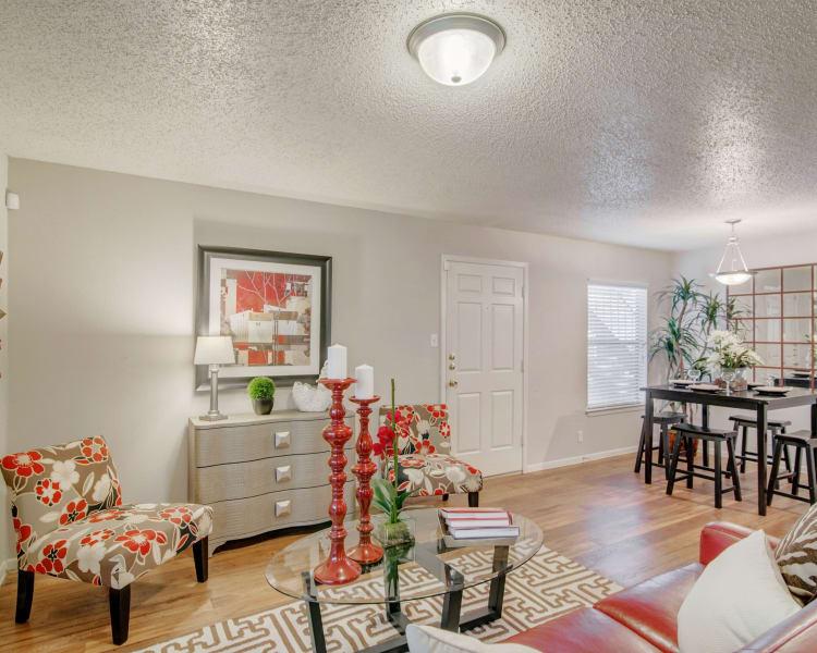 Beautiful apartment interior with hardwood flooring at Retreat at Hart Ranch in San Antonio, Texas