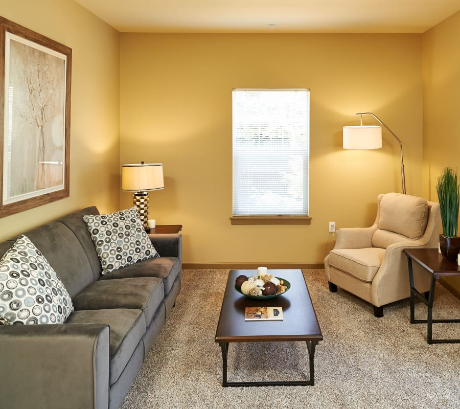 Well decorated living room at Heritage Meadow Apartments home in Eugene, Oregon