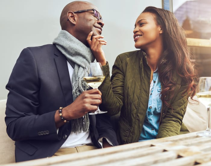 Couple enjoying a glass of wine at Trees of Gainesville