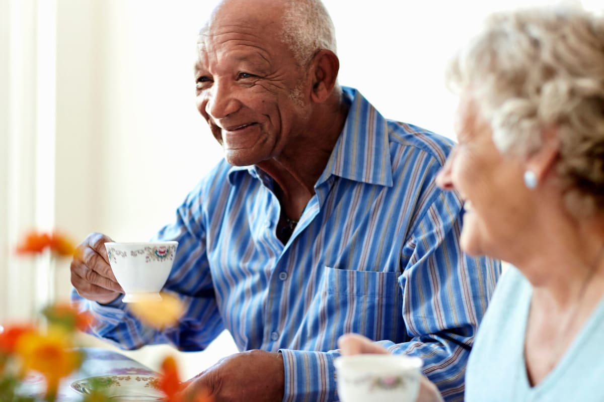 Two residents enjoying tea at The Oxford Grand Assisted Living & Memory Care in Kansas City, Missouri