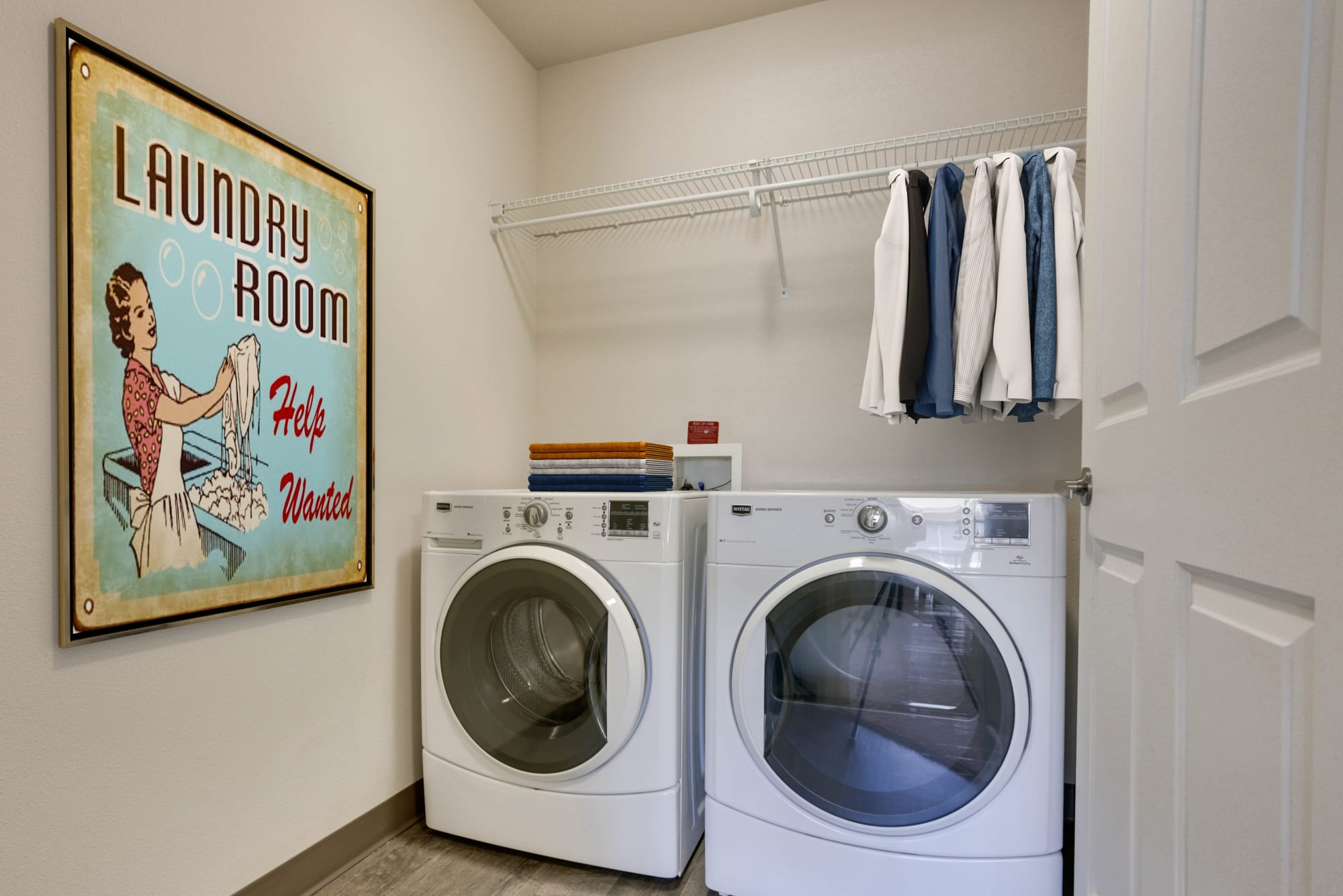 Side-by-side laundry machines at Terrene at the Grove in Wilsonville, Oregon