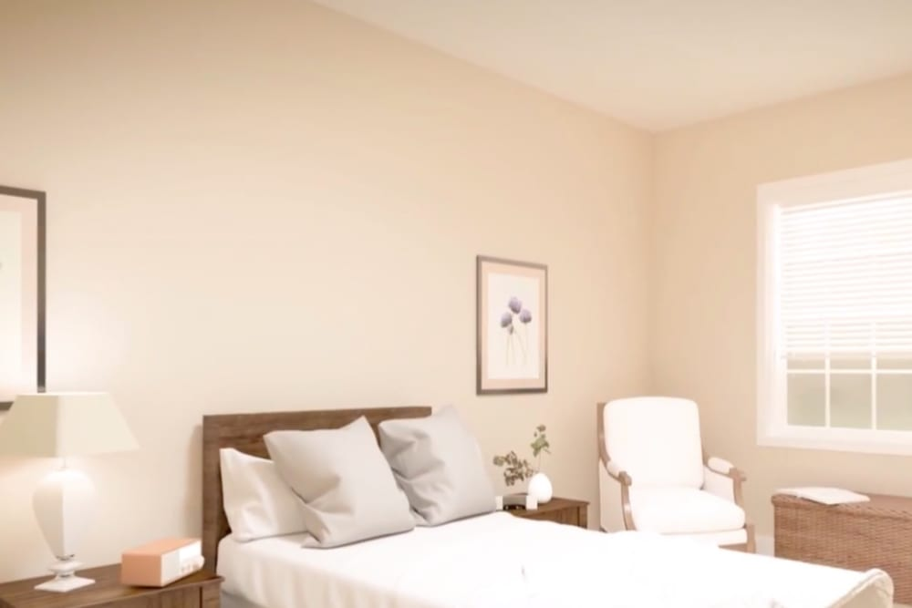 A rendering of a spacious, decorated bedroom at Harmony at Hope Mills in Fayetteville, North Carolina