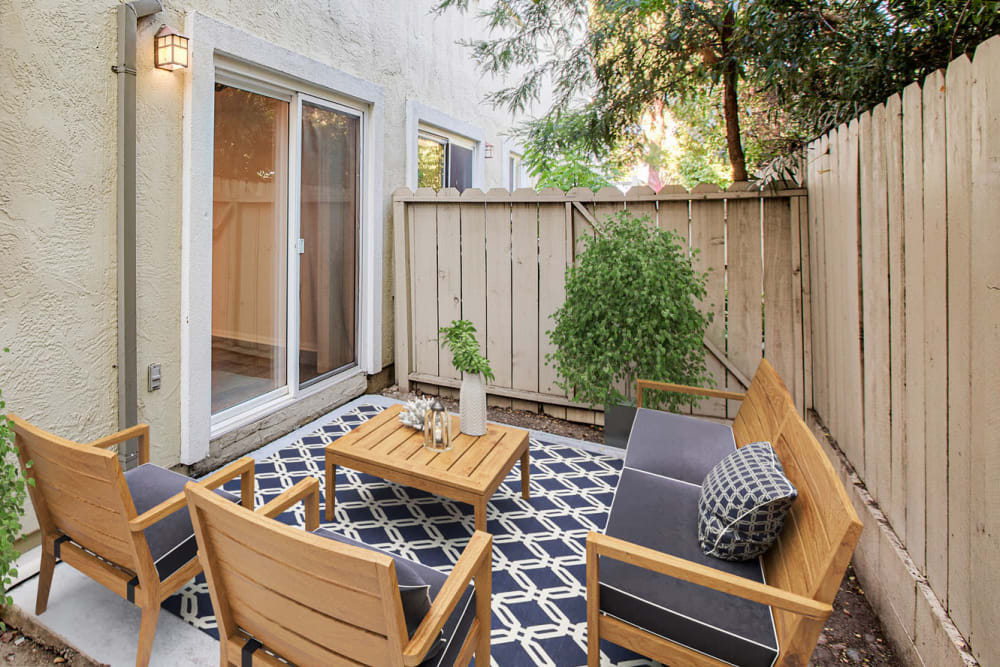 Well-furnished private patio outside a model apartment at Pleasanton Place Apartment Homes in Pleasanton, California