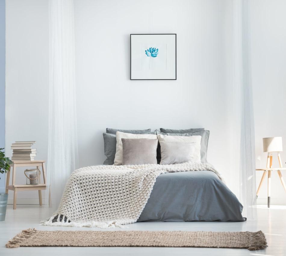 Eclectic decor in the bedroom of a model home at Sofi Ventura in Ventura, California