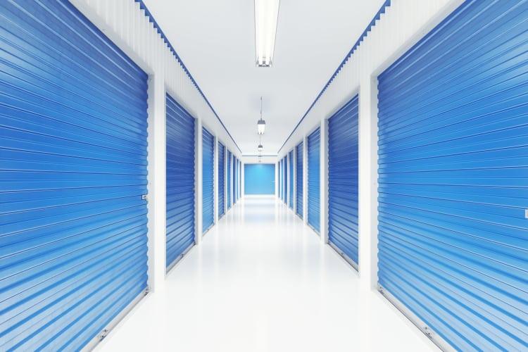 Bright and clean interior storage unit hallway at Storage Star in Dallas, Texas