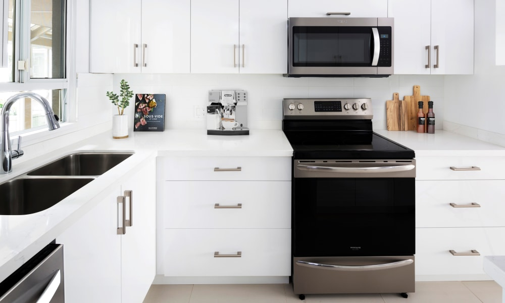 Wonderful kitchen with stainless-steel appliances at Larchway Gardens in Vancouver, British Columbia
