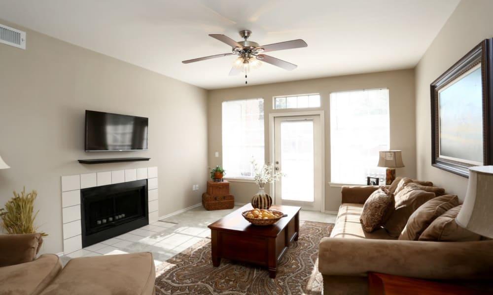 Living room at Champion Lake Apartment Homes in Shreveport, Louisiana