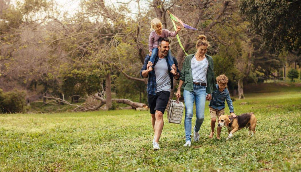 Family walking their dog at a park in Tulsa, Oklahoma near Sheridan Pond
