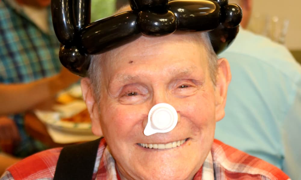 A resident wearing a balloon crown at Summit Glen in Colorado Springs, Colorado