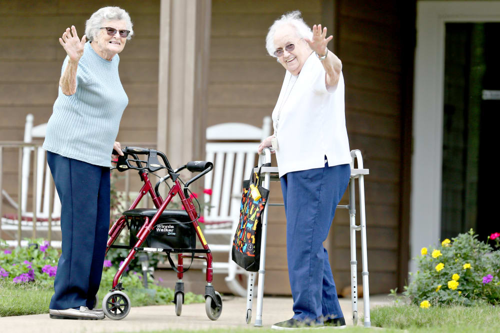 Two residents waving hello at Providence Assisted Living in Searcy, Arkansas.