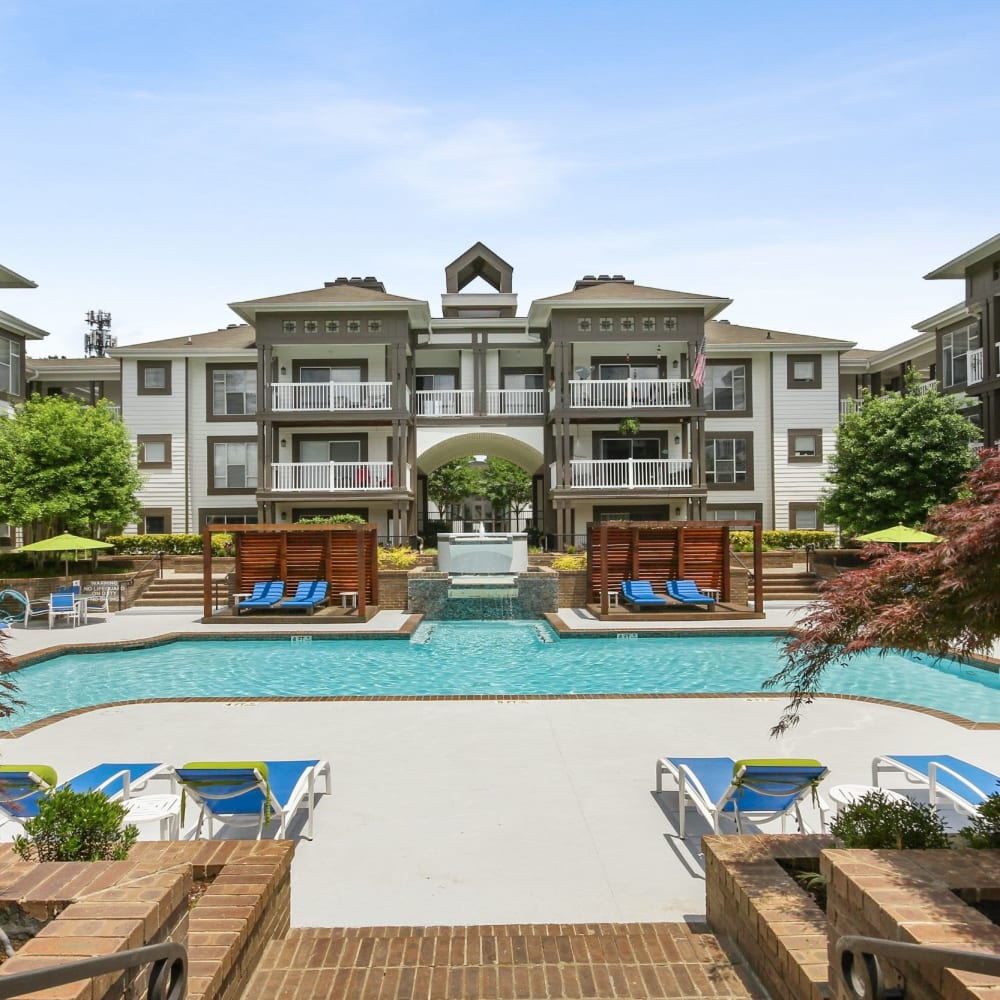 Refreshing swimming pool right next to the clubhouse at 45Eighty Dunwoody Apartment Homes in Dunwoody, Georgia