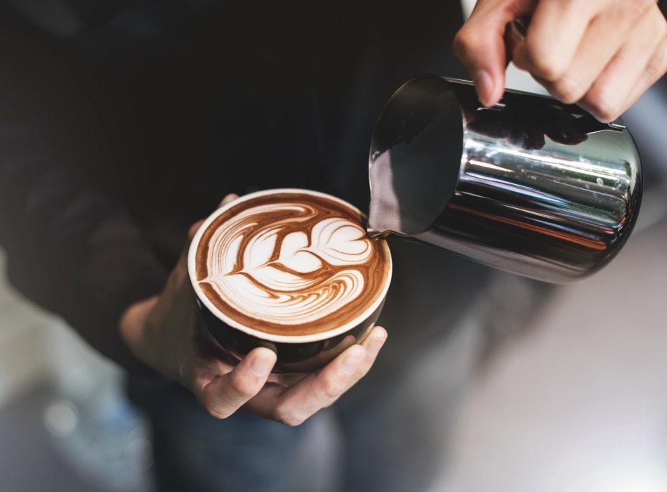 Barista making a latté for a customer near Veranda La Mesa in La Mesa, California