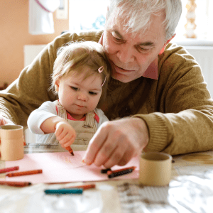 Resident painting with his young grandchild at Hanover Place in Tinley Park, Illinois