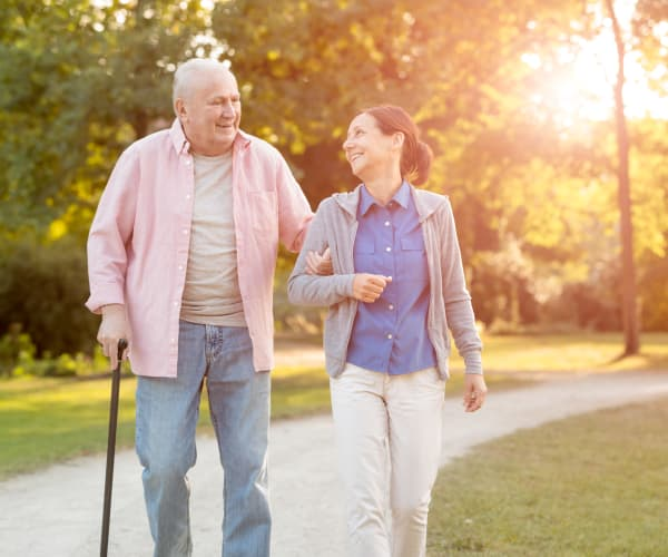 A caretaker walking with a resident at Trilogy Health Services in Louisville, Kentucky
