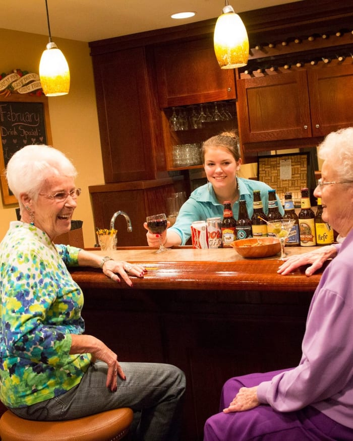 Two residents enjoying drinks at Fancho's at The Springs at Clackamas Woods in Milwaukie, Oregon