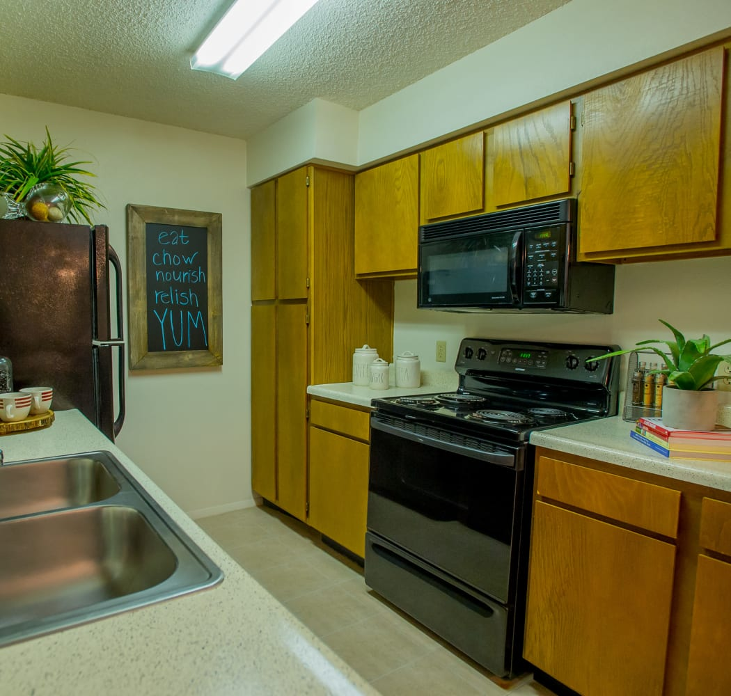 Well equipped kitchen at Cedar Glade Apartments in Tulsa, Oklahoma