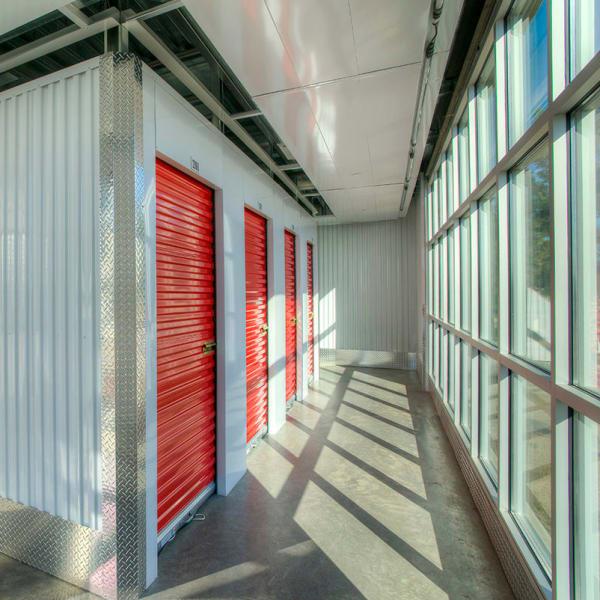 Indoor storage units with red doors at StorQuest Self Storage in Scottsdale, Arizona