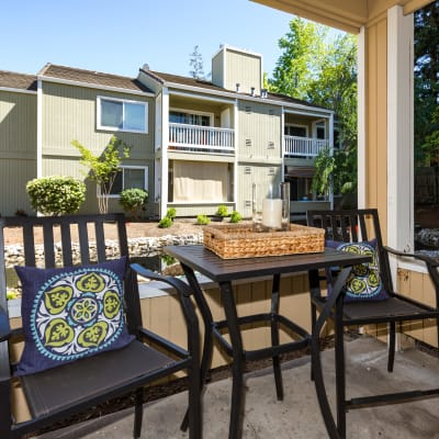 Back patio with tables and chairs at Haven Martinez in Martinez, California