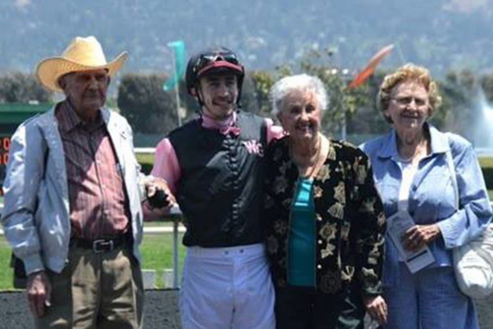 Photo with a jockey our at the horse races near Roseville Commons Senior Living in Roseville, California
