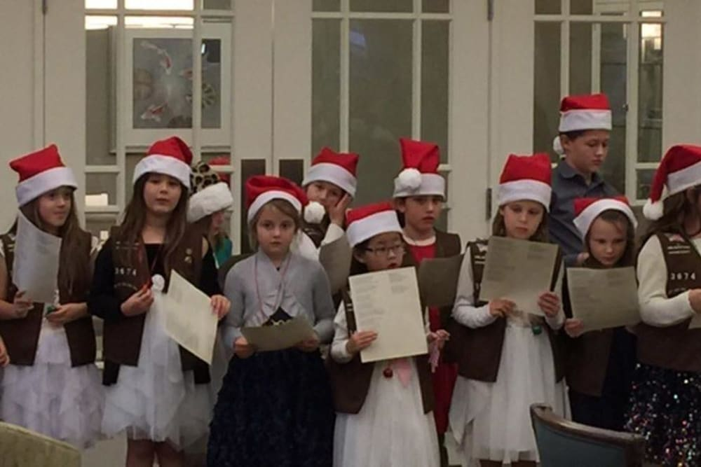 Children Singing for the Holidays at Merrill Gardens at Huntington Beach in Huntington Beach, California.