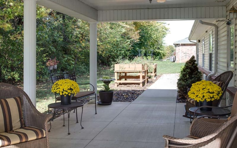 Outdoor walkway with chairs at Lakewood Senior Living in Springfield, Missouri