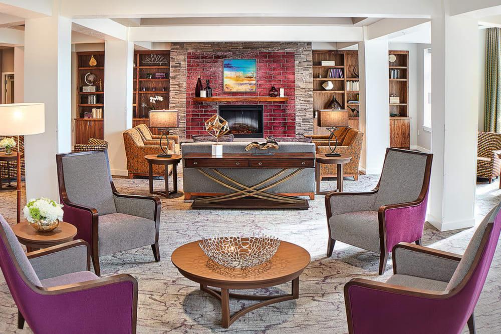 A lounge with a fireplace at Anthology of South Jordan in South Jordan, Utah