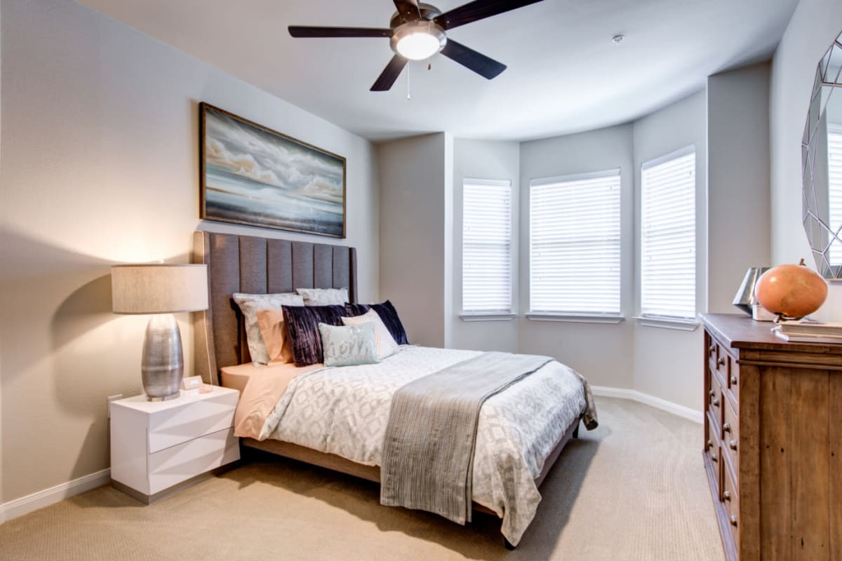 Bedroom with wood style flooring at Marquis at Cinco Ranch in Katy, Texas
