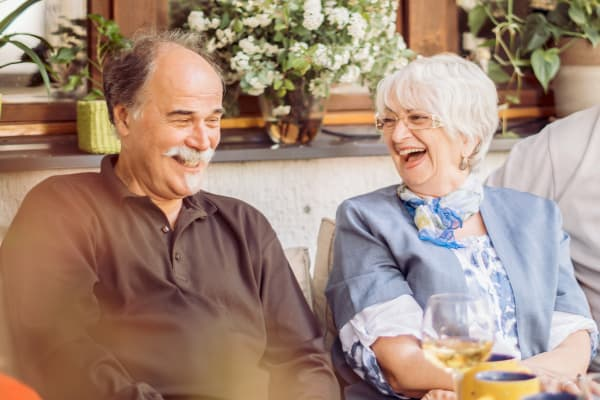 A resident couple laughing at Mountain View Retirement Village in Tucson, Arizona.
