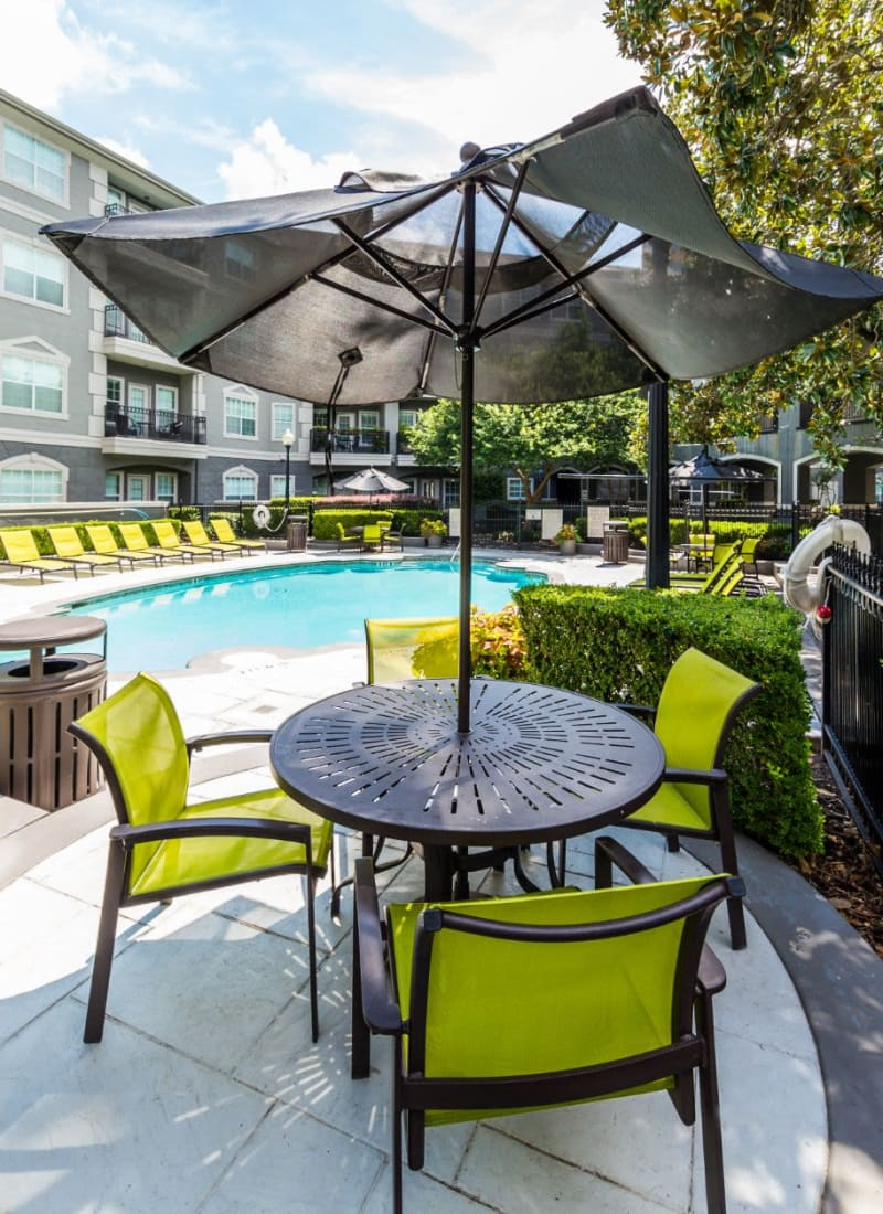Patio furniture next to pool at Marquis at Tanglewood in Houston, Texas