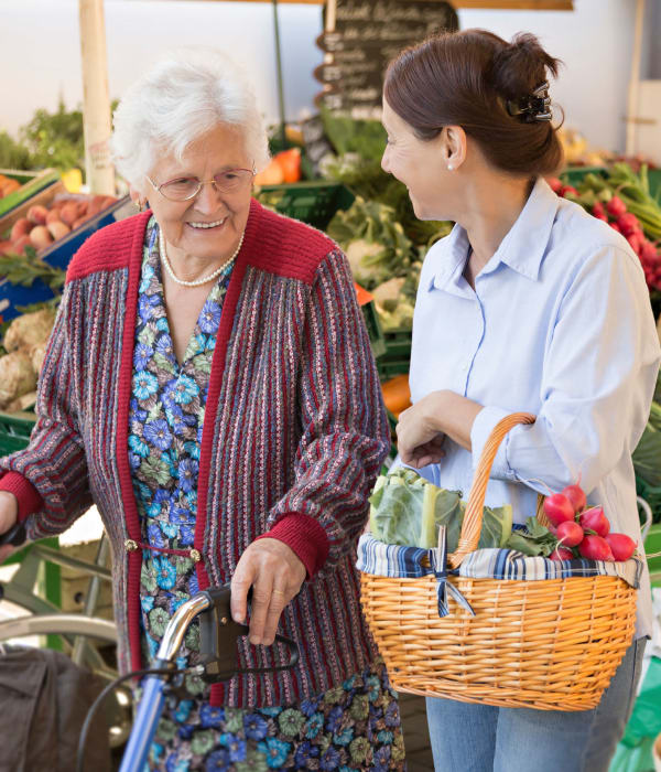 Resident and caretaker shopping at the store near The Phoenix at Estero in Estero, Florida