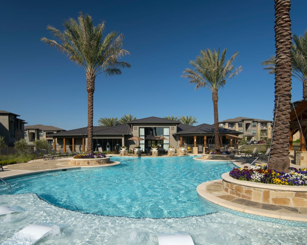 Resident pool with lounge chairs at Savannah Oaks in San Antonio, Texas.