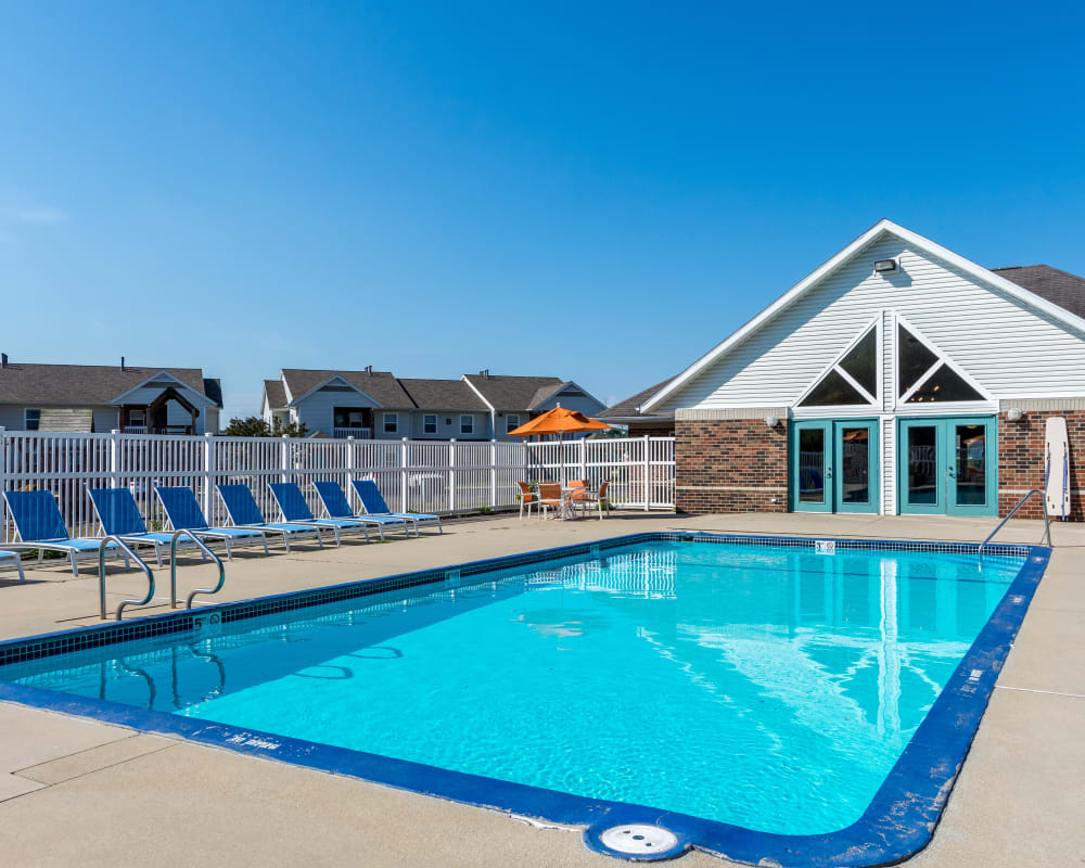 Sparkling swimming pool at Arbor Crossings Apartments in Muskegon, Michigan