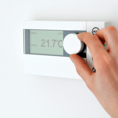 Adjusting a thermostat for temperature controlled storage at A-American Self Storage in Reno, Nevada