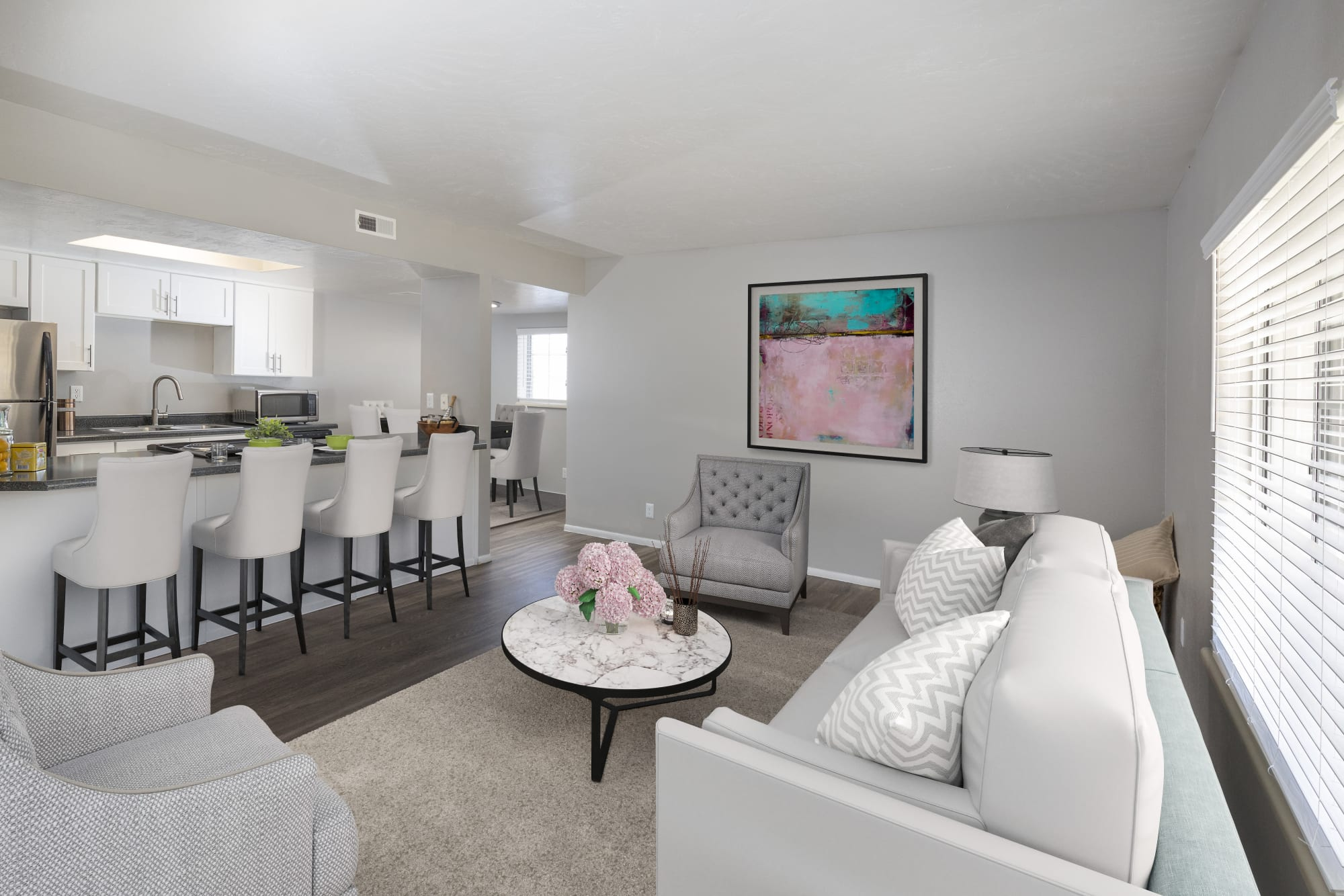 White and bright living room and kitchen at Windgate Apartments in Bountiful, Utah