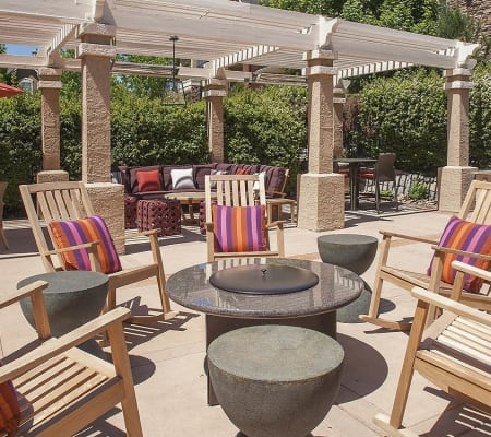 Outdoor lounges around a gas-fueled fire pit in The Vintage at South Meadows Condominium Rentals in Reno, Nevada