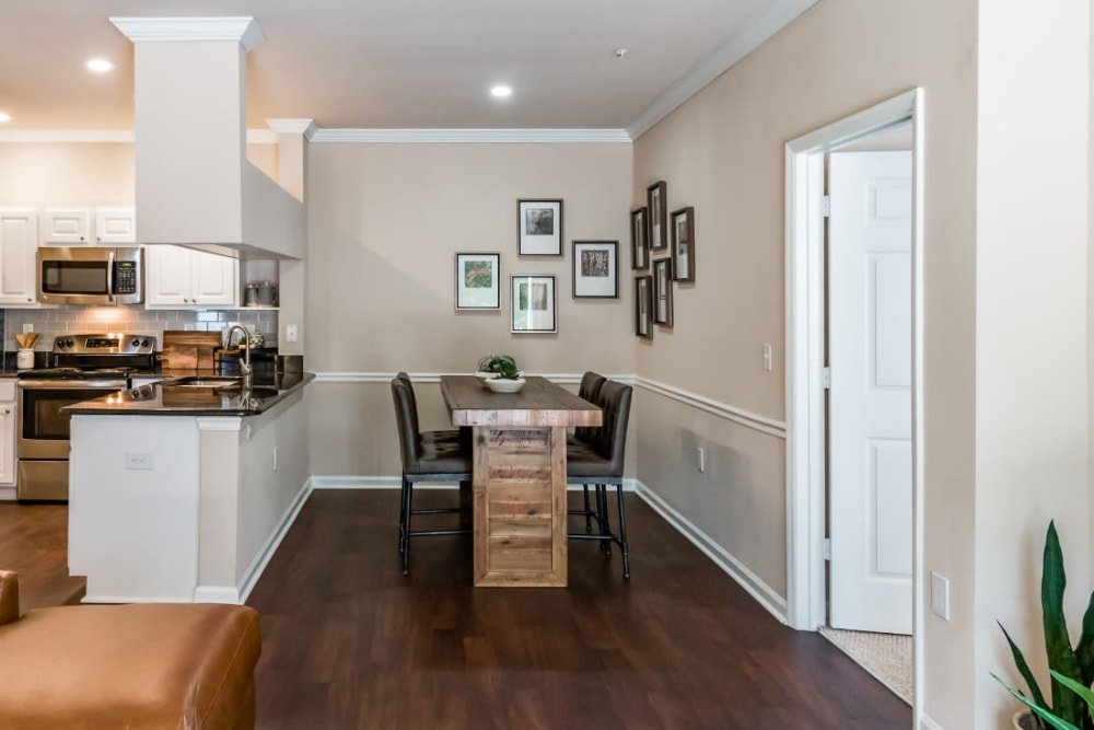 Spacious and bright living area with wood flooring at Marquis at Carmel Commons in Charlotte, North Carolina