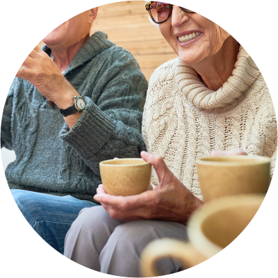 Residents outdoors drinking coffee at Sunstone Village in Denton, Texas