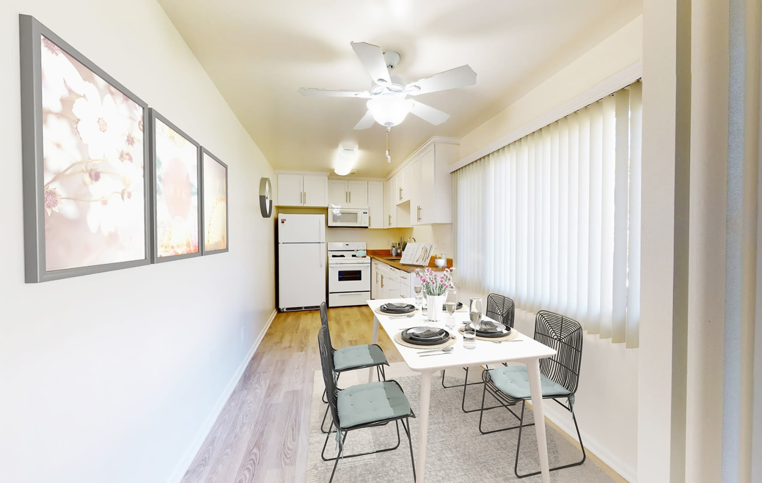 Model two bedroom apartment's kitchen with ample room for dining at West Park Village in Los Angeles, California