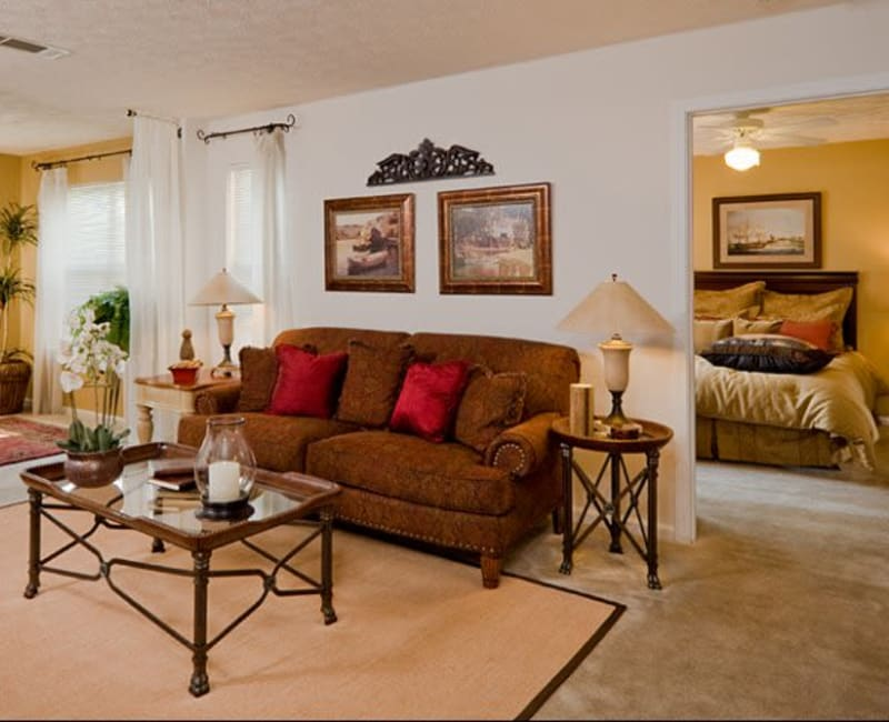 Comfortably decorated living area in a model home at Holland Park in Lawrenceville, Georgia