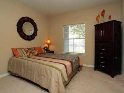Well-lit bedroom at Harbin Pointe Apartments in Bentonville