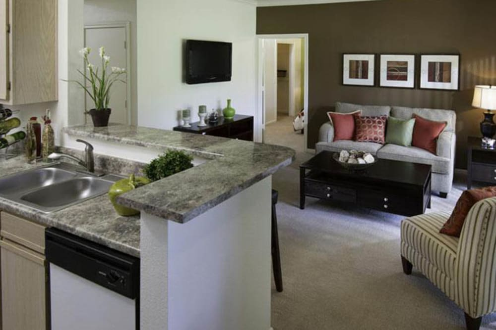 Model kitchen and living room at Alpine Meadows Apartments